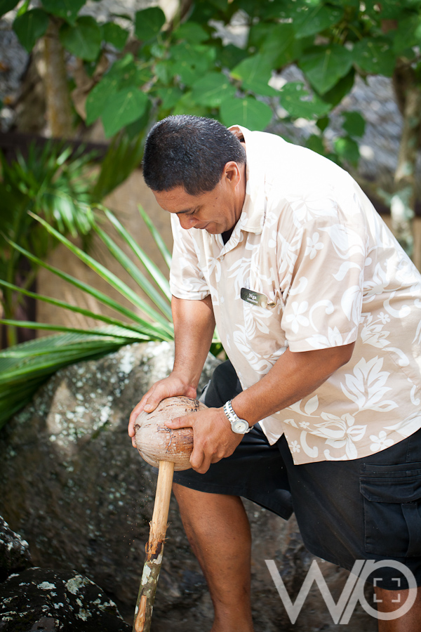 Nga - Aitutaki Pacific Resort breaking coconut
