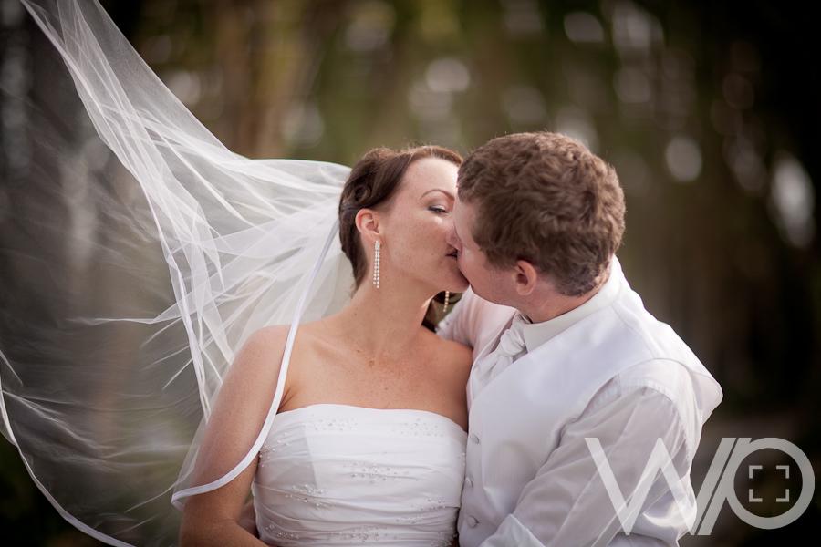 Blowing veil wedding photo