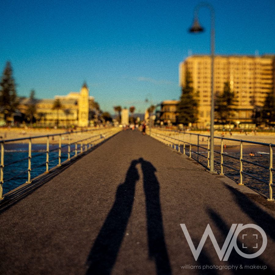 Kiss silhouette on Glenelg Pier