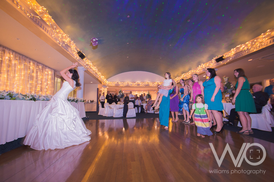 Bouquet toss wedding photos